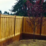 Picture Frame Overlap Fence on Cedar Retaining Wall